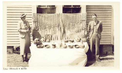 Lear Howell and his wife with looted artifacts from the Spiro and other surrounding sites