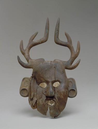 Human face effigy with deer antlers